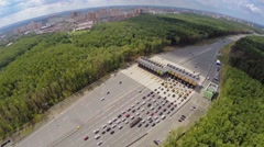 Cityscape with traffic on toll road at summer day. Aerial view Stock Footage