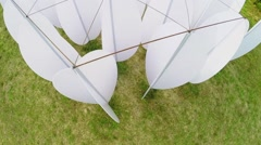 Art object on grass field at summer day. Aerial view Stock Footage