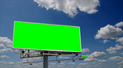 Billboard with a green screen chroma in front of cloudy sky time-lapse, seamless Stock Footage