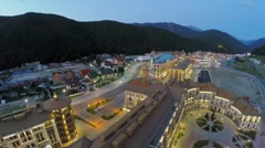 Street traffic in hotel-town Gorky Gorod near mountains at summer Stock Footage