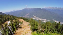 Stock Video Footage of Building site on slope of mountain near ropeway at summer