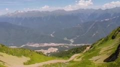 Townscape at foot of mountains in summer sunny day. Aerial view Stock Footage