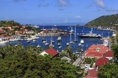 Elevated view of Fort Oscar, Anglican church and yachts in harbour, Gustavia, - stock photo