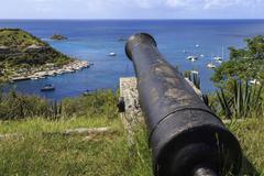Cannon points out to sea and Les Petits Saints islets, Fort Gustave, Gustavia, Stock Photos