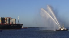 Medium shot - Water salute for MSC Oscar, the worlds largest container ship Stock Footage