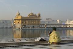 Sikh pilgrim at the Harmandir Sahib (The Golden Temple), Amritsar, Punjab, - stock photo