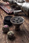 hookah and dry elite tea leaves - stock photo