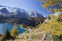 Stock Photo of The majestic Marmolada Group and the Lake Fedaia with its turquoise waters,