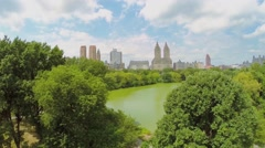 People get fun on Cherry Hill near The Lake in Central Park Stock Footage