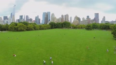 Stock Video Footage of Many people get fun on Sheep Meadow in Central Park at summer