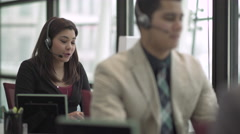 A Mixed Race Woman Works in a Attractive Modern Call Center (5 of 6) - stock footage