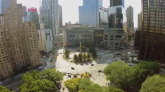 Columbus Circle with traffic at summer sunny day. Aerial view Stock Footage