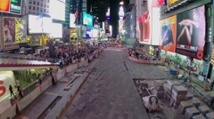 Crowd of people walk by Times Square at summer evening. Stock Footage