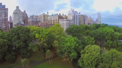 Riverside Park near residential houses at summer evening. Stock Footage