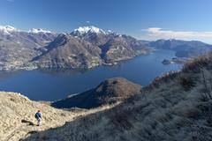 A tourist contemplating the landscape of Lake Como from a path in the High Route Stock Photos