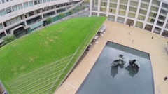 People walk by Hearst Plaza with Paul Milstein Pool and Terrace Stock Footage