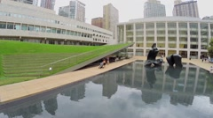 People walk by Hearst Plaza with Paul Milstein Pool and Terrace. Stock Footage
