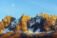 Moon rising over Aiguilles des Chamonix, Chamonix, Rhone Alps, Haute Savoie, Stock Photos