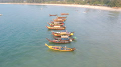 Long tail boats beach ocean aerial Stock Footage