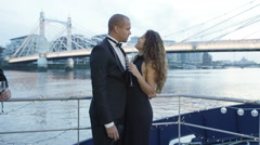 4K Romantic couple in love kiss on the deck of a party boat on River Thames Stock Footage
