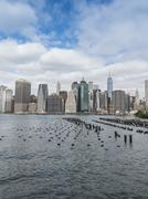Stock Photo of Lower Manhattan financial district skyline and East River, New York City, New