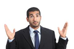 Arab business man with a doubt gesturing Stock Photos