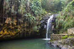 Woman looking at the Annandale Falls, Grenada, Windward Islands, West Indies, Stock Photos