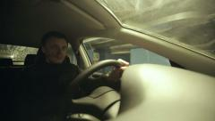 The man driving the car in the underground parking Arkistovideo
