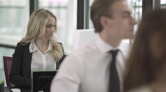 A Blonde Caucasian Woman Works in a Attractive Modern Office (2 of 2) - stock footage
