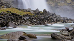 Beautiful timelapse with flowing water and waterfall. Panning up video. Stock Footage