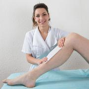 Removing hair from man leg - waxing legs - stock photo