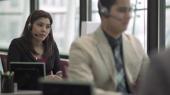 A Mixed Race Woman Works in a Attractive Modern Call Center (6 of 6) - stock footage