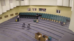 Stock Video Footage of Installation of new seats in the auditorium