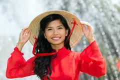 Smiling vivacious Vietnamese woman - stock photo