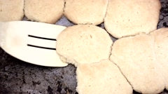 Removing sugar cookies from pan Stock Footage