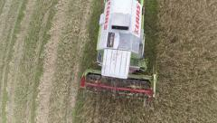 Aerial footage of a Combine Harvester Passing Directly Under the Camera Stock Footage