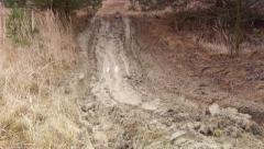 Muddy path - impassable trails - rutted road - the effect of floods Stock Footage