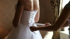 The morning of the bride preparing for the wedding, dressing Stock Footage