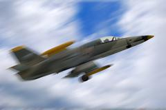 fighter jet airplane in motion - stock photo