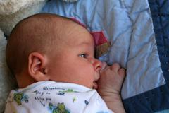 Stock Photo of Baby on Tummy