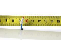 man busy wih measurement tool - stock photo