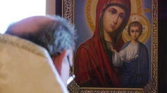 the priest reads the prayer, reading the Bible - stock footage