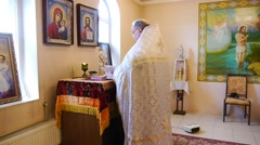 The priest reads the prayer, reading the Bible Stock Footage