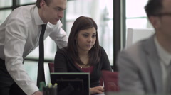 A Mixed Race Woman Works in a Attractive Modern Office (3 of 7) Stock Footage