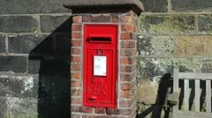 Red post box English Stock Footage