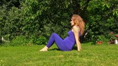pregnant woman make exercise for leg in garden. Prenatal health. - stock footage