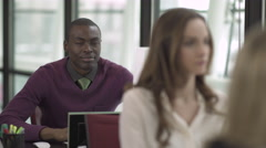 A Black Man Works in a Attractive Modern Office (1 of 2) - stock footage