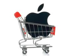 Apple logotype printed on paper and placed into shopping cart Stock Photos