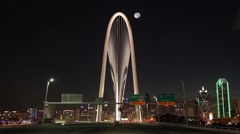 Dallas Skyline time-laspe with bridge traffic and rising full moon Stock Footage