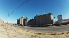 Large Grain Elevator With Moving Train In Foreground Stock Footage